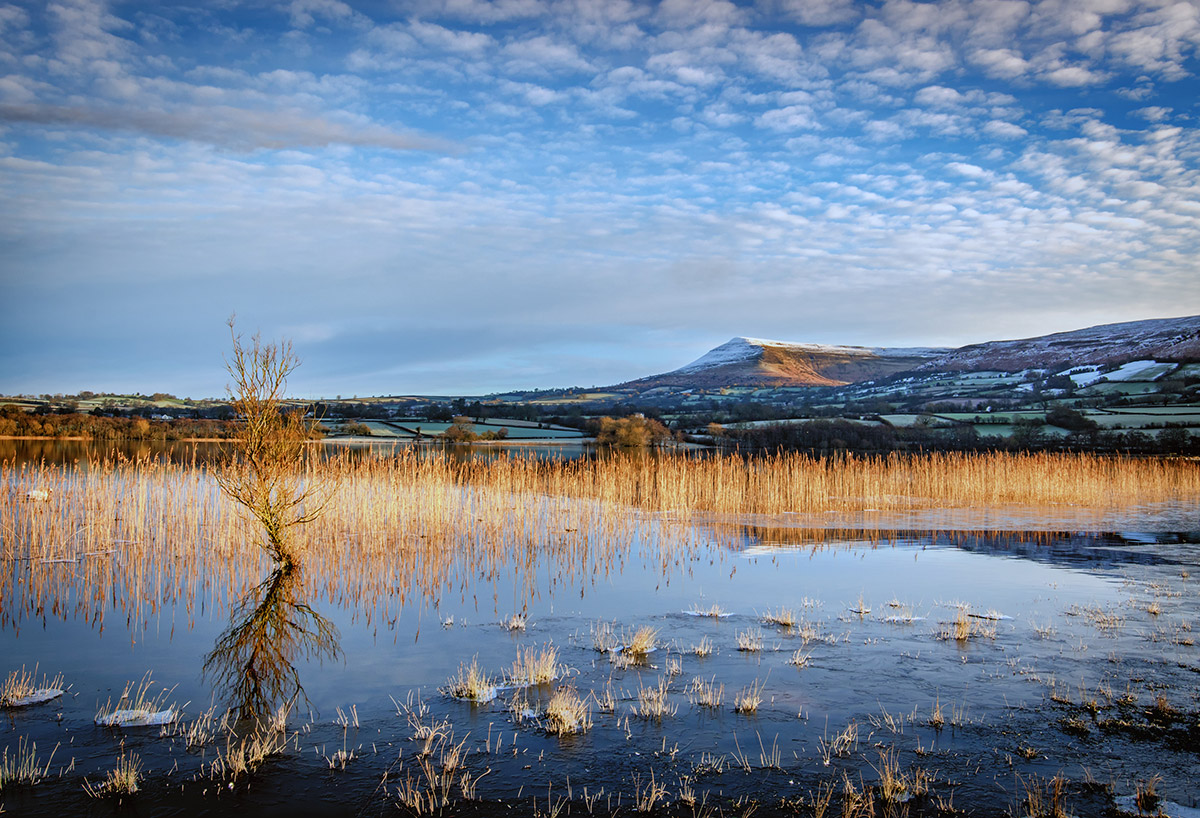 Dawn of Langorse Lake in Wales as the Dawn Sunlight Kisses Talgarth Moutain
